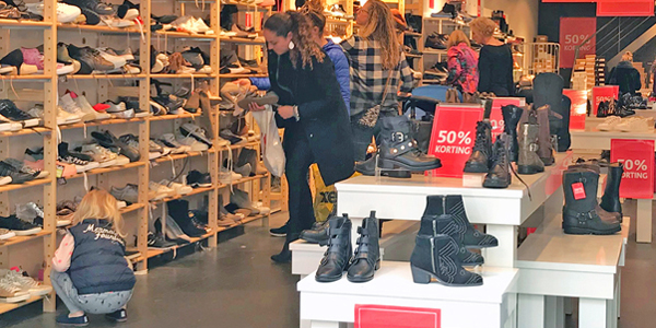 customers trying on shoes in Dutch retail store in Netherlands