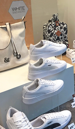 white sneaker trend display at shoe store chain in Netherlands